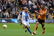 Wolverhampton Wanderers midfielder Connor Hunte tackles Blackburn Rovers striker Simeon Jackson 0-0 during the Sky Bet Championship match between Wolverhampton Wanderers and Blackburn Rovers at Molineux, Wolverhampton, England on 9 April 2016. Photo by Alan Franklin.