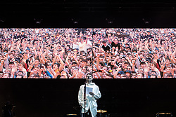 © Licensed to London News Pictures . 27/05/2017 . Manchester , UK . LIAM FRAY reads a short poem to honour those killed at a terrorist attack at an Ariana Grande show at the Manchester Arena , ahead of the Courteeners' set . Manchester music line up , featuring Courteeners , Charlatans , Blossoms and Cabbage , at the Emirates Old Trafford Stadium . Photo credit : Joel Goodman/LNP