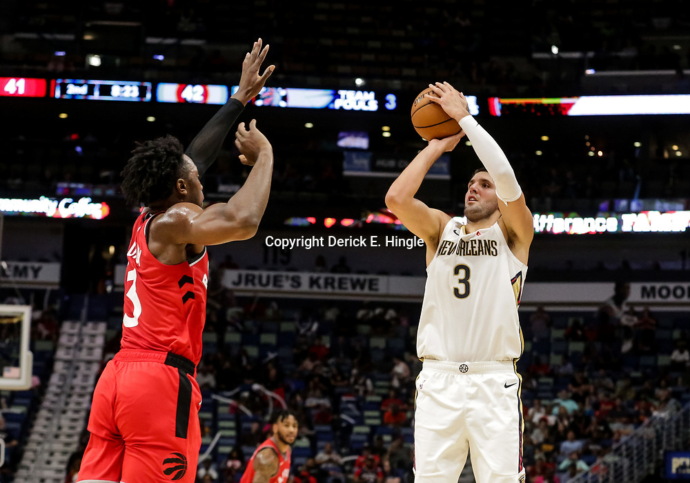 Oct 11, 2018; New Orleans, LA, USA; New Orleans Pelicans forward Nikola Mirotic (3) shoots over Toronto Raptors forward OG Anunoby (3) during the first half at the Smoothie King Center. Mandatory Credit: Derick E. Hingle-USA TODAY Sports