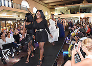 Photo by Mara Lavitt -- Special to the Hartford Courant<br /> October 4, 2015 <br /> Hartford Fashion Week, last day, Union Station, Hartford.<br /> Six designers showed their fashions. Saints by S.J. fashion house designers and sisters Natacha Saint Juste, left, and Anise Saint Juste of New Britain walk to the runway at the end of their show.