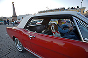 During summer from June to Septemper, every first Friday of the month is Vintage Car Cruising Night. Hundreds of classic American cars cruise around downtown Helsinki and meet at special places to have a good time, here at Kauppatori (Market Square). A beagle as co-pilot in a Ford Mustang hardtop.