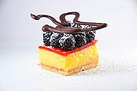 Meyer Lemon Bar, Macadamia Shortbread Crust, Strawberry Gelee Top, Fresh Blackberries, Chocolate Ornament, Strawberry Coulis