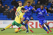 Norwich City defender Grant Hanley (31) battles with Cardiff City striker Omar Bogle (30) and Cardiff City midfielder Junior Hoilett (33) 1-1 during the EFL Sky Bet Championship match between Cardiff City and Norwich City at the Cardiff City Stadium, Cardiff, Wales on 1 December 2017. Photo by Alan Franklin.