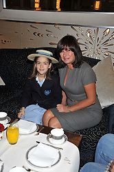 MIRANDA JONES and her daughter STELLA at the launch of Stephen Webster Bijoux Tea held at the Langham Hotel, Portland Place, London on 13th September 2011.