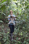 Brown-throated Three-toed Sloth <br /> Bradypus variegatus<br /> Rebecca Cliff, sloth biologist, carrying sloth wearing &quot;sloth backpack&quot; to release site<br /> Aviarios Sloth Sanctuary, Costa Rica<br /> *Model release available