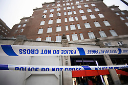 © Licensed to London News Pictures. 03/01/2019. London, UK. A police cordon remains in place outside the entrance doorway to 80 Park Lane in Mayfair, where security guard Tudor Simionov was stabbed to death in the early hours of New Year's day. The 33-year-old and his colleagues were attacked by a group of men who were trying to gain entry to a party at Fountain House, a £12.5 million townhouse in London's West End.. Photo credit: Ben Cawthra/LNP