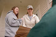Meg Alexander(hat),Jen Toole(OU green jacket), and Amelia Hogan(grey sweater)...11.8.06...Off-campus Ohio University students to help community members in need..ATHENS, Ohio (Nov. 8, 2006) - Ohio University students living off-campus will have the opportunity to empty their cupboards and pantries for a good cause when the Off-Campus Community Assistants will collect non-perishable food items from student residents and community members living in the off-campus community Wednesday, Nov. 15. The food items will be donated to the Athens Food Pantry. ..?This project was conceptualized and organized by students and has the potential to be one of the largest community service projects accomplished at Ohio University,? said Kevin Smith, graduate assistant for Off-Campus Living. ?Best of all, this project will benefit the Athens Food Pantry and those people whom the food pantry seek to assist.?..The Community Assistant program is now in its second year at Ohio University and consists of 15 undergraduate students who live throughout the off-campus area. These students serve as peer educators, liaisons between the students and the university, as well as information providers and potential problem-solvers for off-campus students who otherwise have no direct outlet for their concerns. ..?This is a chance for off-campus students to show Athens residents that we truly care about our community? said Community Assistant Student Coordinator Meg Alexander. ..On Nov. 15, each street's community assistant will go door-to-door distributing paper grocery bags to collect any non-perishable food items. Additionally, students may plan ahead and register their contribution and/or their assistance in the collection process at: www.ohio.edu/offcampus/fooddrive.cfm...A total of $400 in prizes will be awarded to those students who donate the most non-perishable food items. ..This community-building project is being sponsored in part by Off-Campus Living and CampusMenus.com with assistance from