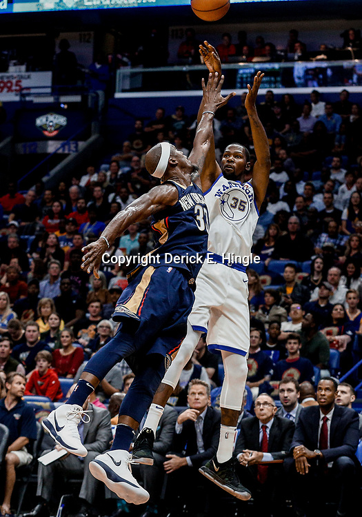 Oct 20, 2017; New Orleans, LA, USA; Golden State Warriors forward Kevin Durant (35) shoots over New Orleans Pelicans forward Dante Cunningham (33) during the first quarter of a game at the Smoothie King Center. Mandatory Credit: Derick E. Hingle-USA TODAY Sports