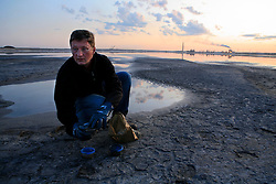 CANADA ALBERTA FORT MCMURRAY 20JUL09 - Greenpeace Germany campaigner Christoph von Lieven collects water and soil samples from the tailings pond next to the Syncrude upgrader plant north of Fort McMurray, northern Alberta, Canada...jre/Photo by Jiri Rezac / GREENPEACE..© Jiri Rezac 2009
