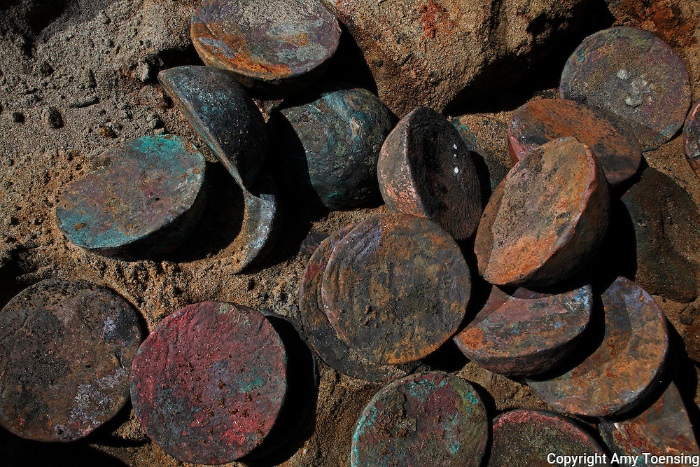 ORANJEMUND, NAMIBIA -- SEPTEMBER 30: Copper ingots found on site of the discovered Portuguese shipwreck on September 30, 2008 in Oranjemund, Namibia. The wreck was uncovered by miners in the Namdeb diamond mine off the coast of Namibia. The ship was found seven meters below sea level on April 1, 2008. Archeologists presume the wreck is from the early 1500s. Most of the the artifacts found are being stored in a storage shed at the Namdeb Diamond Mine. Items include: copper ingots, bronze canons, canon balls, pewter bowls and plates, ivory tusks from African elephants, and most substantial over 2000 gold coins - approximately 21 kg - the most gold found in Africa since the Valley of the Kings in Egypt. (Photo by Amy Toensing) _________________________________<br /> <br /> For stock or print inquires, please email us at studio@moyer-toensing.com.