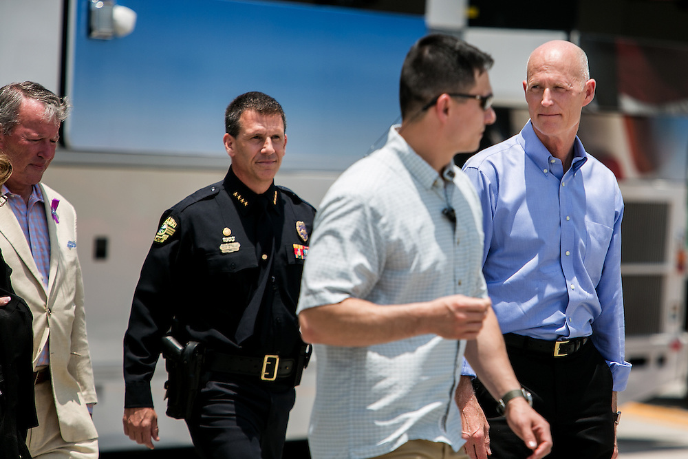 ORLANDO - JUNE 15, 2016: Orlando Mayor Buddy Dyer, Police Chief John Mina and Florida Governor Rick Scott head to a press conference outside the Pulse nightclub in Orlando, Florida. CREDIT: Sam Hodgson for The New York Times.