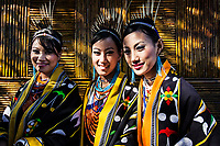 A portrait of three women from the Chakhesang tribe in Nagaland, India. The girls are dressed in traditional wear for the opening ceremony of the Hornbill Festival, which takes place every year during the first week of December.
