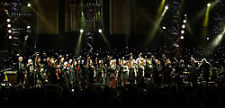 "© Licensed to London News Pictures. 16/09/2012. London, UK.  A choir  performs at The Sunflower Jam at the Royal Albert Hall.  The Sunflower Jam is a British charity, founded by Jacky Paice, wife of Deep Purple drummer, Ian Paice. Other high-profile supporters are the actor Jeremy Irons, ex-Jamiroquai bassist Nick Fyffe and Charles, Prince of Wales. The aims of the charity are to fund complementary therapists and spiritual healers to work on cancer wards in the British National Health Service. After setting up a meeting between members of Deep Purple and a young boy dying of leukemia, Paice saw ""all the good work the healers were doing"" and decided ""lets find a way to raise money to get more healers in there. Photo credit : Richard Isaac/LNP"