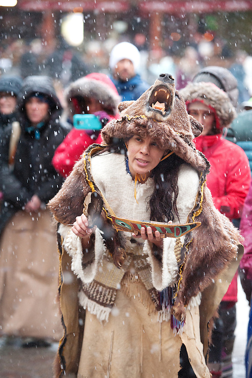 St'atimt bear dancer jackie Andrew performs in the Whistler Village prior to leaving for the Standing Rock demonstrations in North Dakota.  Sunday, Nov 27, 2016.<br /> <br /> Photo:  David Buzzard