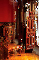 Ornately carved furniture within the Antoni Gaudi designed Palau Guell in Barcelona, Spain