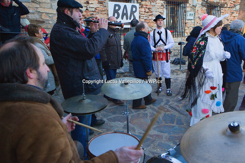 Folk musicians, Mascarita and Botarga. Carnival, Almiruete. Tamajon, Guadalajara province, Castilla-La Mancha, Spain