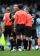 John Terry argues with Referee A Marriner after the final whistle of the Barclays Premier League match between Manchester City and Chelsea at the City of Manchester Stadium on September 25, 2010 in Manchester, England.