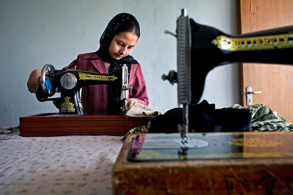 Afghanistan 2008. .In an orphange in Mazar-e-Sharif, run by the Red Cross, children are tought to make carpets and sew clothes..Photo: Markus Marcetic/MOMENT