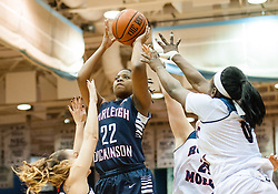 March 6 2016: Fairleigh Dickinson Lady Knights guard Kiana Brown (22) puts up a jump shot over Robert Morris Colonials defenders during the first half in the NCAA Women's Basketball game between the Fairleigh Dickinson Lady Knights and the Robert Morris Colonials at the Charles L. Sewall Center in Moon Township, Pennsylvania (Photo by Justin Berl)