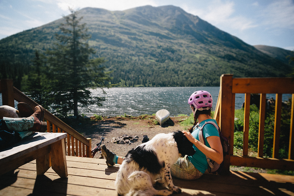 Heather Goodrich talks with horse riding locals at the Trout Lake Cabin in the Chugach National Forest near Cooper Landing, Alaska.