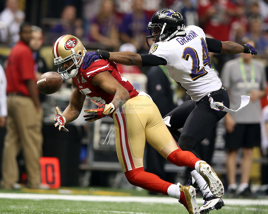 Corey Graham (24) of the Baltimore Ravens breaks up a pass to Michael Crabtree (15) of the San Francisco 49ers during the NFL Super Bowl XLVII football game in New Orleans on Feb. 3, 2013. The Ravens won the game, 34-31.  (Photo by Jed Jacobsohn)
