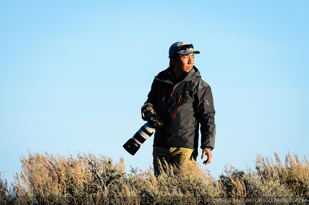 Wildlife photojournalist Noppadol Paothong at work in Wyoming near White Mountain. ©John L. Dengler / DenglerImages.com