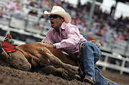 Steer Roper Marvin Dan Fisher Jr. barks commands to his horse during competition with a final time of 20.6, 26 July 2007, Cheyenne Frontier Days