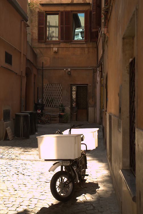 Scooter in alleyway in Rome, Italy