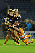 Darcy Graham under pressure during the Guinness Pro 14 2018_19 match between Edinburgh Rugby and Toyota Cheetahs at BT Murrayfield Stadium, Edinburgh, Scotland on 5 October 2018.