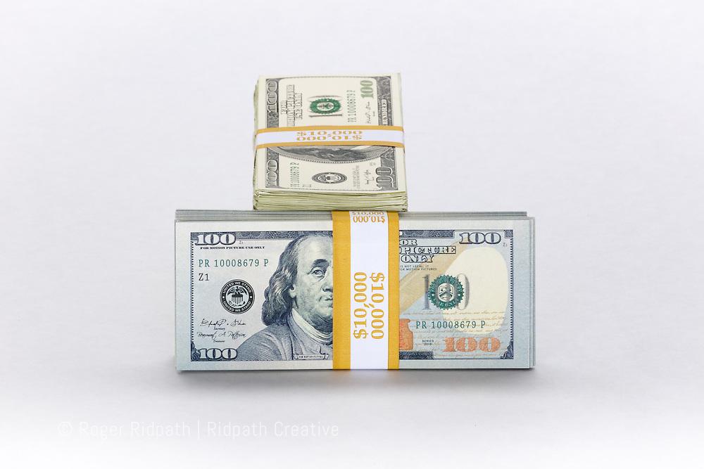 American $100 bills paper money with Benjamin Franklin peaking