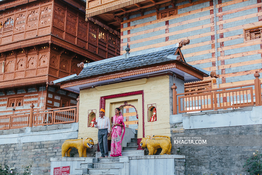 A couple from Kolkata posing for a photograph in front of the Bhima Kali Temple, Sarahan, Shimla, Himachal Pradesh