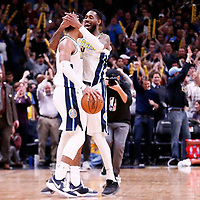 09 April 2018: Denver Nuggets guard Gary Harris (14) celebrates with Denver Nuggets forward Will Barton (5) during the Denver Nuggets 88-82 victory over the Portland Trail Blazers, at the Pepsi Center, Denver, Colorado, USA.