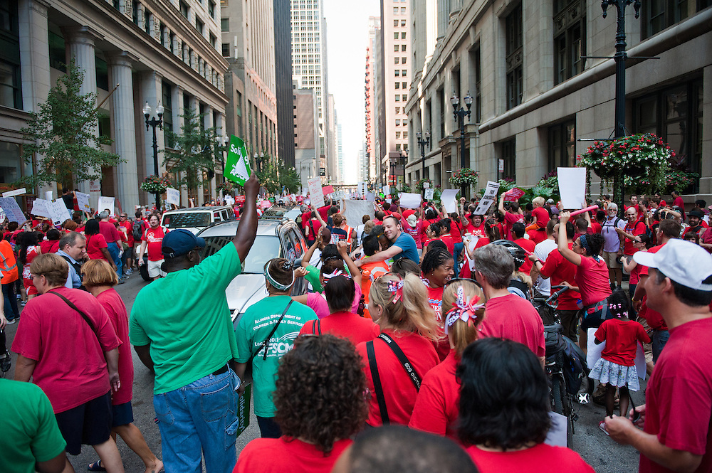 The Chicago Teachers Union and supporters march outside City Hall.