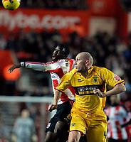 Photo: Alan Crowhurst.<br />Southampton v Burnley. Coca Cola Championship. 13/01/2007. Burnleys John McGreal (R) clears the ball away from  Bradley Wright-Philips.