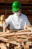 Safety inspector holding broken pieces of wood