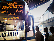 04 JANUARY 2015 - BANGKOK, THAILAND: Passengers board a bus bound for Khonglan, Thailand, at the Mo Chit Bus Station. Mo Chit, also called the Northern Bus Station, is the largest bus station in Thailand. Buses from Mo Chit go to most places in Thailand, including the Isan region, the northern cities of Chiang Mai and Chiang Rai, and the Burmese border. Millions of Thais hit the road Sunday returning to Bangkok after the long weekend New Year holiday. Train stations and trains were packed and the state owned bus company scheduled thousands of extra buses to handle the demand.    PHOTO BY JACK KURTZ