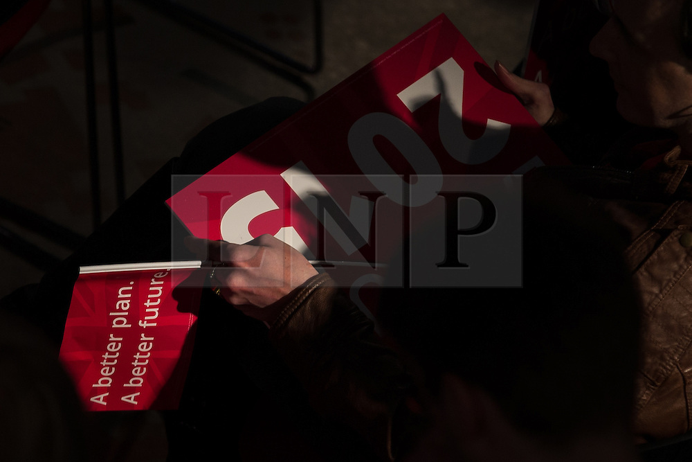 © Licensed to London News Pictures . 06/05/2015 . Leeds , UK . A Labour Party supporter with a supporting flag in Leeds City Museum for a Labour Party Rally address by Ed Miliband , on the eve of polls opening for the 2015 British general election . Photo credit : Joel Goodman/LNP