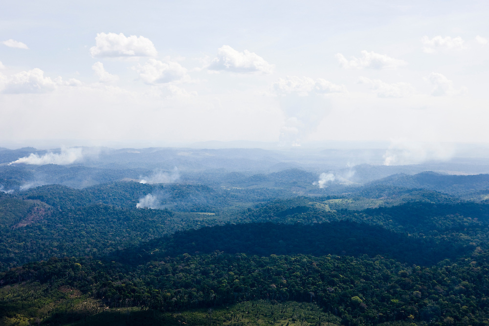 Fires burn Amazon rainforest land to clear the ground for cattle or crop farming in Itaituba Municipality, Para State, Brazil, August 13, 2008..Daniel Beltra/Greenpeace
