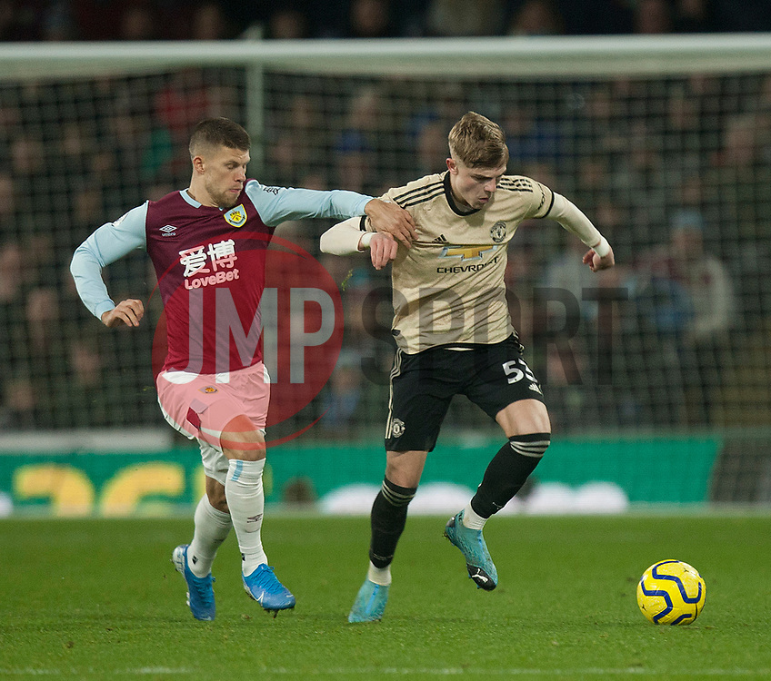Brandon Williams of Manchester United (R) and Johann Gudmundsson of Burnley in action - Mandatory by-line: Jack Phillips/JMP - 28/12/2019 - FOOTBALL - Turf Moor - Burnley, England - Burnley v Manchester United - English Premier League