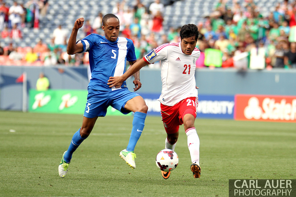 July 14 2013:  Mexico Forward Javier Orozco (21) makes a move to get past Martinique Midfield Gael Germany (5) in the second half of the CONCACAF Gold Cup soccer match between Martinique and Mexico at Sports Authority Field in Denver, CO. USA.