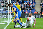 Swansea City defender Ashley Williams tackles Leicester City midfielder Andy King during the Barclays Premier League match between Leicester City and Swansea City at the King Power Stadium, Leicester, England on 24 April 2016. Photo by Alan Franklin.