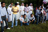 Members of the Islamic Society of Southeast Kansas gather for a group photo outside Pittsburg Masjid after celebrating Eid ul-Fitr with a morning feast, Sep. 10, 2010. The mosque, founded in 1999, is the only one in Southeast Kansas. It serviced Northeast Oklahoma and Southwest Missouri until a newer mosque was established in Joplin, MO a few years ago.