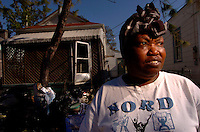 """We went to Baton Rouge...then to Shelton...I have to go back, because we cant stay here.""  New Orleans resident, Theresa Odom's, home was destroyed by floodwaters following Hurricane Katrina two months prior. ..."