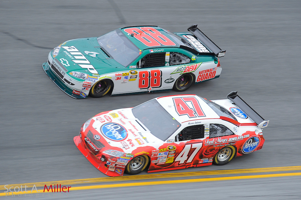Feb. 11, 2010; Daytona Beach, FL, USA; NASCAR Sprint Cup Series drivers Dale Earnhardt Jr. (88) and Marcos Mabrose go side by side heads into turn 4 during race two of the Gatorade Duel at Daytona International Speedway. ©2010 Scott A. Miller