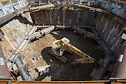 "Shaft excavation is conducted in ""levels"", and each level requires heavy duty steel reinforcements, prior to  bottoming out the shaft and pouring the reinforced floor slab."