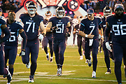 Tennessee Titans inside linebacker Will Compton (51) runs onto the field with teammates during pregame player introductions before the week 14 regular season NFL football game against the Jacksonville Jaguars on Thursday, Dec. 6, 2018 in Nashville, Tenn. The Titans won the game 30-9. (©Paul Anthony Spinelli)