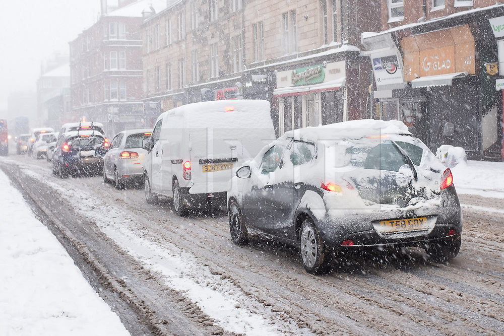 "© Licensed to London News Pictures. 28/02/2018. <br /> <br /> Heavy traffic on Pollockshaws Road, Glasgow, Scotland as the city hit with snow storm ""Beast from the East"" on 28th February 2018.<br /> <br /> Photo credit should read Max Bryan/LNP"
