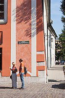 Tourists read their map on Ulica Kanonicza street in Krakow Poland