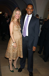 ADAM AFRIYIE MP  and his wife TRACY-JANE at a dinner attended by the Conservative leader Michael Howard and David Davis and David Cameron held at the Banqueting Hall, Whitehall, London on 29th November 2005.<br />