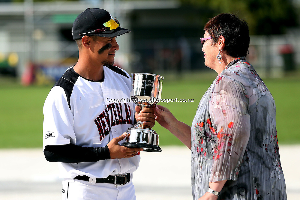 Captain Nathan Nukunuku of the Black Sox receives the Oceania Cup after game three of the Trans Tasman Softball Series between the New Zealand Black Sox and the Australian Steelers at Tradestaff Rosedale Park in Albany, Auckland on 29 March 2014. Photo: Jason Oxenham / www.photosport.co.nz